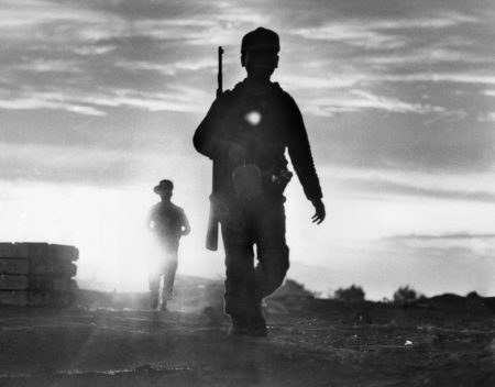 Montagnard soldiers make a sunset patrol near Plei Me, about 210 miles north of Saigon, during a siege by Viet Cong guerrillas, Oct. 24, 1965. The Viet Cong retreated after several days of fighting.
