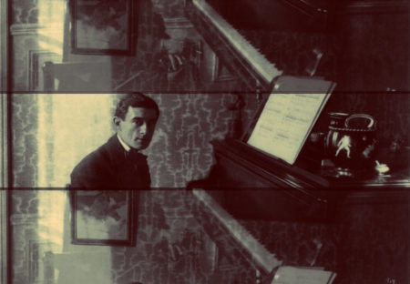 Portrait of Maurice Ravel at the piano in 1914.