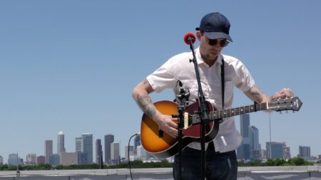 Justin Townes Earle performs on the roof of the Melcher Center for Public Broadcasting