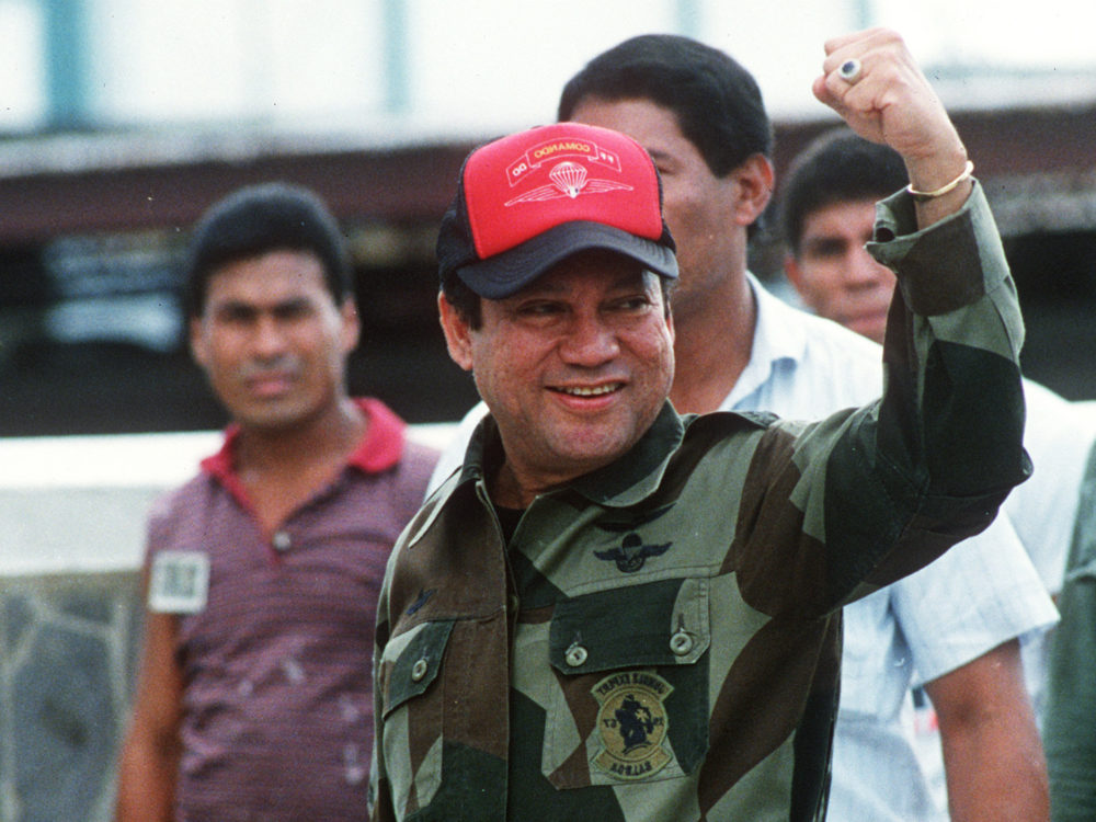 In this 1989 photograph, Noriega waves while leaving his headquarters in Panama City following a failed coup against him. It was just months before Noriega would surrender power amid a U.S. military operation against his government.