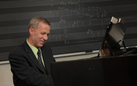 Composer Mark Kilstofte at piano