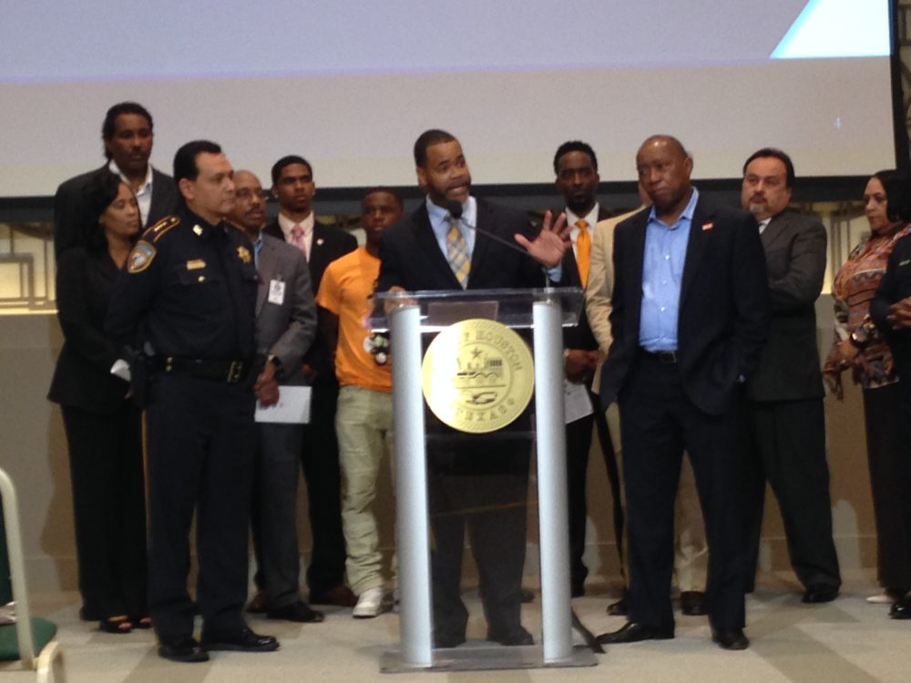 Karlton Harris (center), who works for the City's Health Department –which manages My Brother's Keeper in Houston— speaks about the new programs during a press conference held at City Hall.