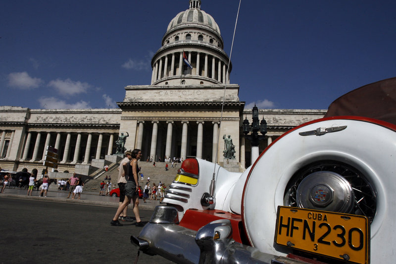 An American classic car is seen parked in front of the Capitol building in Havana. President Trump's expected changes in policy toward Cuba could make it more difficult for Americans to visit the island and for U.S. companies to do business there. Javier Galeano/AP