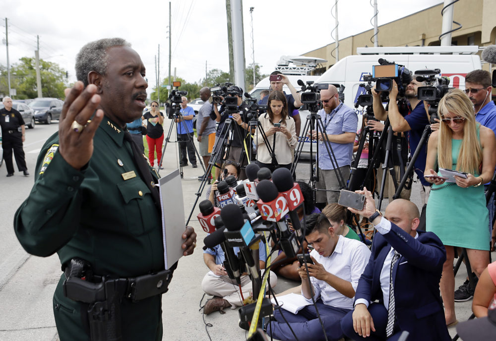 Orange County Sheriff Jerry Demings, left, answers questions at a news conference near the scene of a shooting where there were multiple fatalities in an industrial area near Orlando, Fla., Monday, June 5, 2017. The Orange County Sheriff's Office said on its official Twitter account that the situation has been contained.