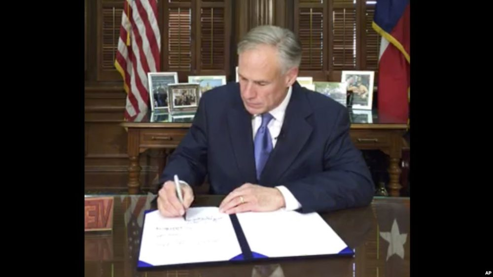 "Texas Governor Greg Abbott signs the ""Sanctuary Cities"" bill, SB 4, into law on Facebook Live."