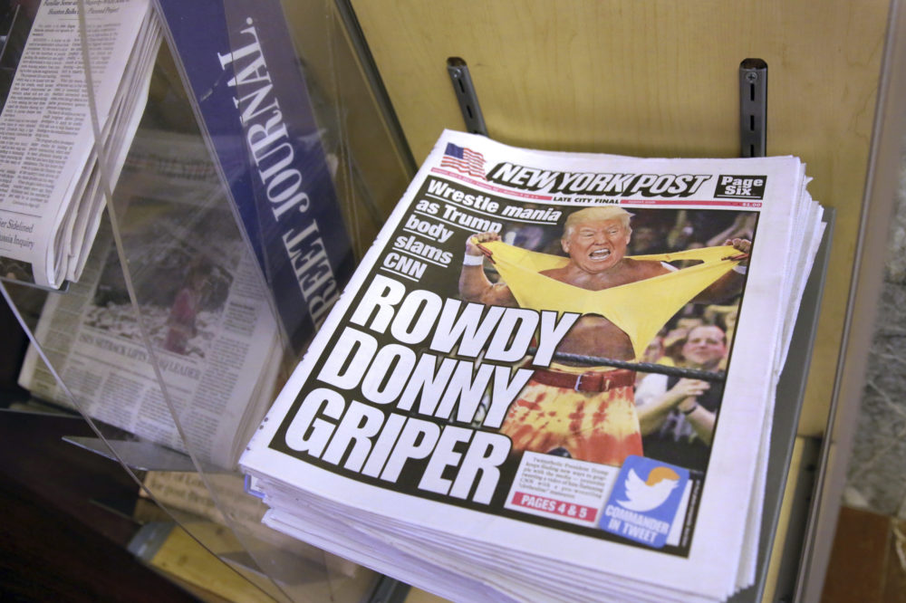 Copies of the New York Post with an illustration of President Donald Trump as a professional wrestler on the front page are displayed at a newsstand in New York City, Monday, July 3, 2017. On Sunday, Trump's apparent fondness for wrestling emerged in a tweeted mock video that shows him pummeling a man in a business suit with his face obscured by the CNN logo.