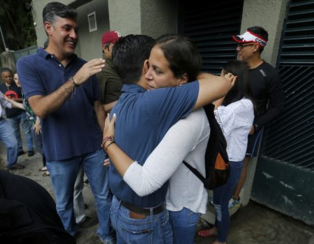 """Supporters of opposition leader Leopoldo Lopez celebrate outside his home in Caracas, Venezuela, Saturday, July 8, 2017. Lopez has been transferred to house arrest. The court says in a statement early Saturday that Lopez was granted the """"humanitarian measure"""" for health reasons. The 46-year-old Lopez has been behind bars at a military prison for more than three years."""