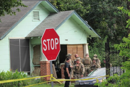 HPD SWAT team looks for additional suspects after officers are fired upon in the Third Ward.