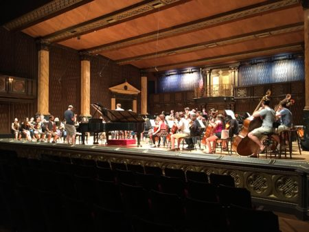 Conductor and orchestra in Festival Concert Hall.