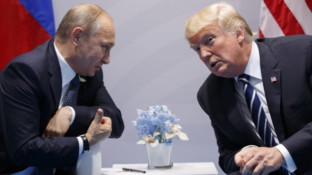President Donald Trump meets with Russian President Vladimir Putin at the G-20 Summit in early July. It's unclear how sanctions Trump signed into law this week will affect the personal relationship between the two men.