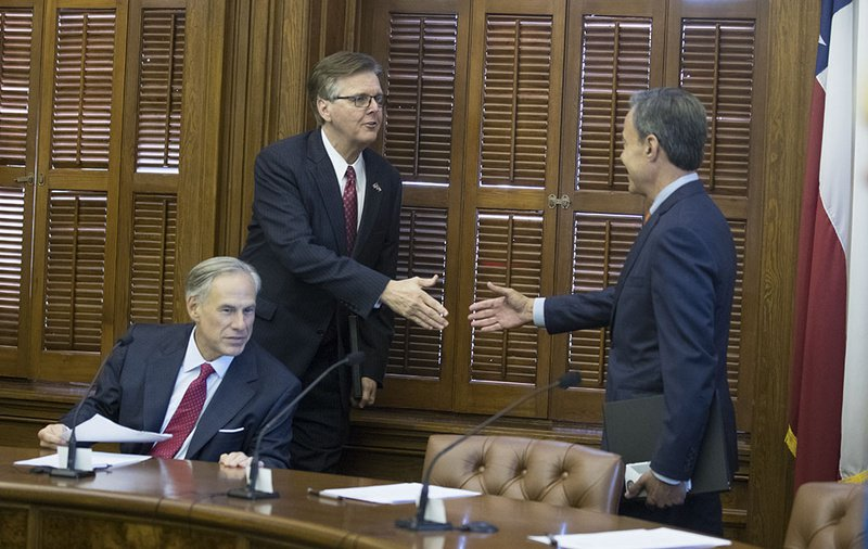 Gov. Greg Abbott, Lt. Gov. Dan Patrick and House Speaker Joe Straus meet at the short Cash Management Committee meeting on July 18, 2017.