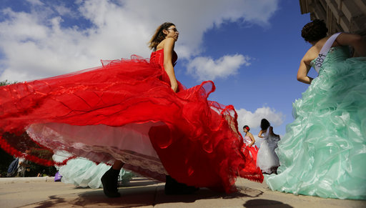 "Young women dressed as Quinceaneras perform and protest SB4, an anti-""sanctuary cities"" bill, at the Texas Capitol in Austin, Texas, Wednesday, July 19, 2017. The ""sanctuary cities"" ban, signed in May, lets police ask people during routine stops whether they're in the U.S. legally."