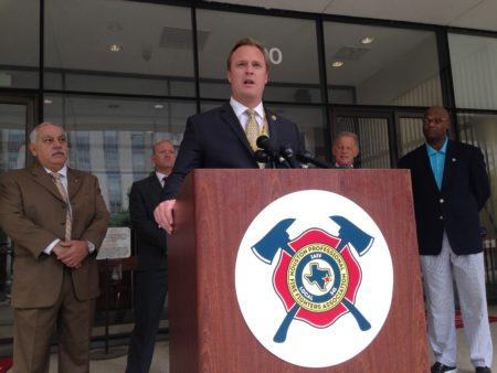 Marty Lancton, president of the Houston Professional Fire Fighters Association, speaks at a press conference held at the entrance to the City Hall Annex building, in downtown Houston.