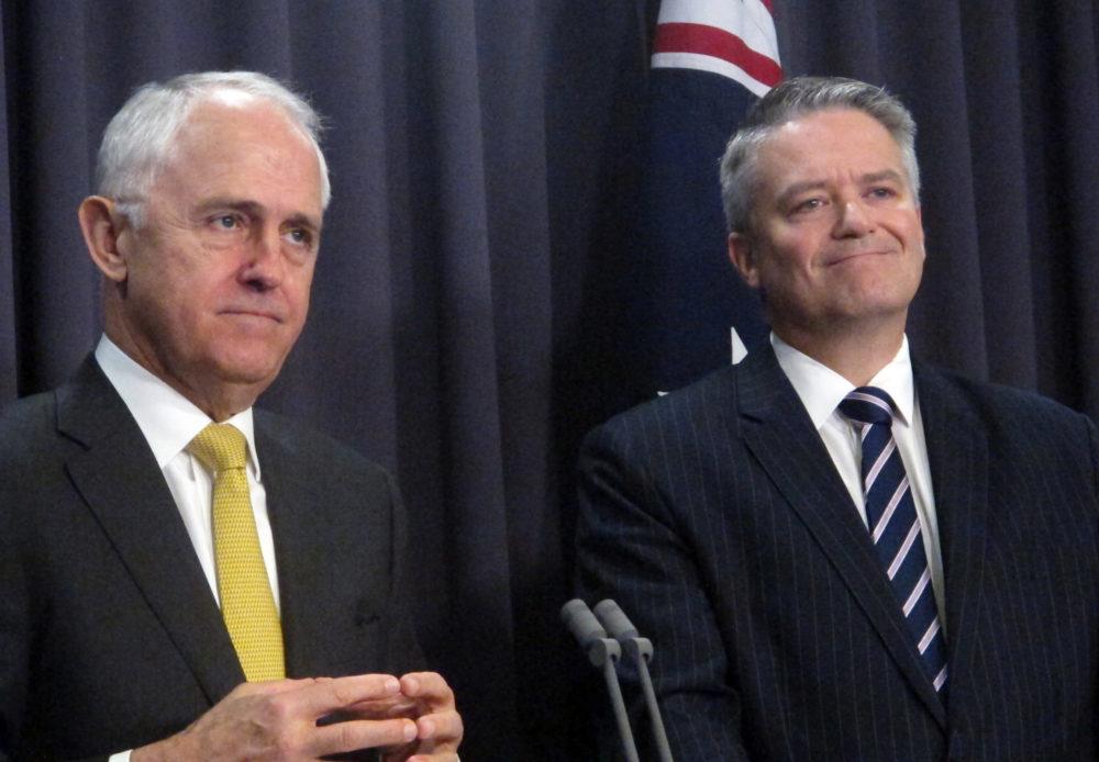 Australian Prime Minister Malcolm Turnbull (left) says Parliament could legalize same-sex marriage this year if the nation's voters endorse it. He spoke about the issue on Tuesday with Finance Minister Mathias Cormann at Parliament House in Canberra.