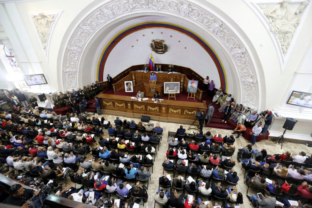 Constitutional Assembly delegate Carmen Melendez speaks from the podium during a session in Caracas, Venezuela, Tuesday, Aug. 8, 2017. The government-backed assembly that is recasting Venezuela's political system filed into the stately domed chamber where congress normally meets. In two previous sessions, the 545-member assembly met in an adjacent, smaller building.