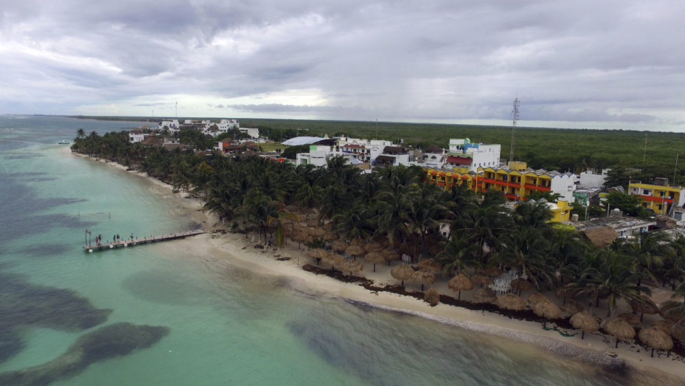 Clouds hang over the town of Mahahual, Quintana Roo state, Mexico, after the passage of Tropical Storm Franklin, Tuesday, Aug. 8, 2017. Residents said parts of the beach had shrunk by several meters the morning after the storm struck. A weakened Tropical Storm Franklin chugged across Mexico's Yucatan Peninsula Tuesday, dumping heavy rain after coming ashore on the Caribbean coast.