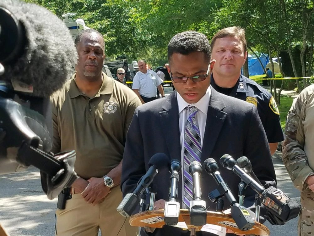 FBI ASAC Deron Ogletree and HPD Assistant Chief Larry Satterwhite (behind) speak at a press conference in the 2200 block of Albans in Houston this morning