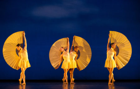 MOMIX dancers in yellow light