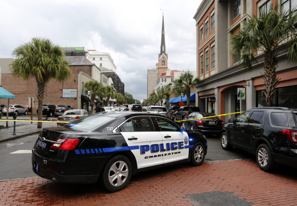 Charleston, S.C. Police Department block access to King Street in front of the restaurant Virginia's on King in Charleston, S.C.,Thursday, Aug. 24, 2017. A disgruntled employee shot a gun in the restaurant and a hostage situation happened after the shooting. Charleston Mayor John Tecklenburg  says the hostage situation has ended with the gunman being shot by police.
