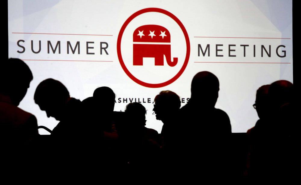 People talk before the start of the meeting of the standing committee on rules at the Republican National Committee summer meeting, Thursday, Aug. 24, 2017, in Nashville, Tenn.