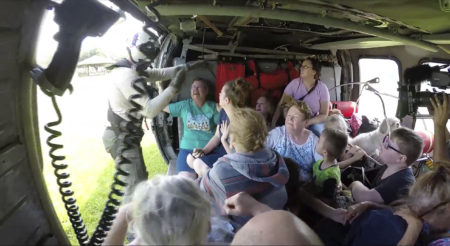 This still image taken from video provided by the U.S. Navy shows sailors from Helicopter Sea Combat Squadron (HSC) 28 rescuing 14 people and four dogs, at Pine Forrest Elementary School, in Vidor, Texas on Thursday, Aug. 31, 2017. The shelter that required evacuation after flood waters from Hurricane Harvey reached its grounds.