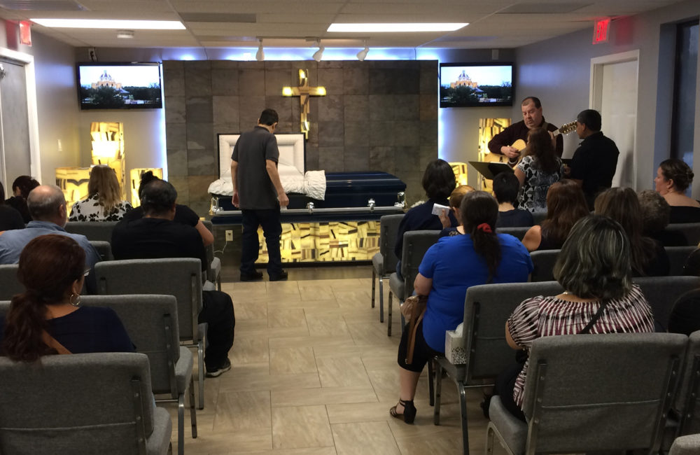 Mourners gather for Harvey victim Benito Juarez Cavazos at Del Pueblo Funeral Home in Houston, Texas, Friday, Sept. 1, 2017. Cavazos, 42, was found dead in a parking lot after floodwaters receded Tuesday near a Houston freeway. His death was being listed by police as a drowning or accident.