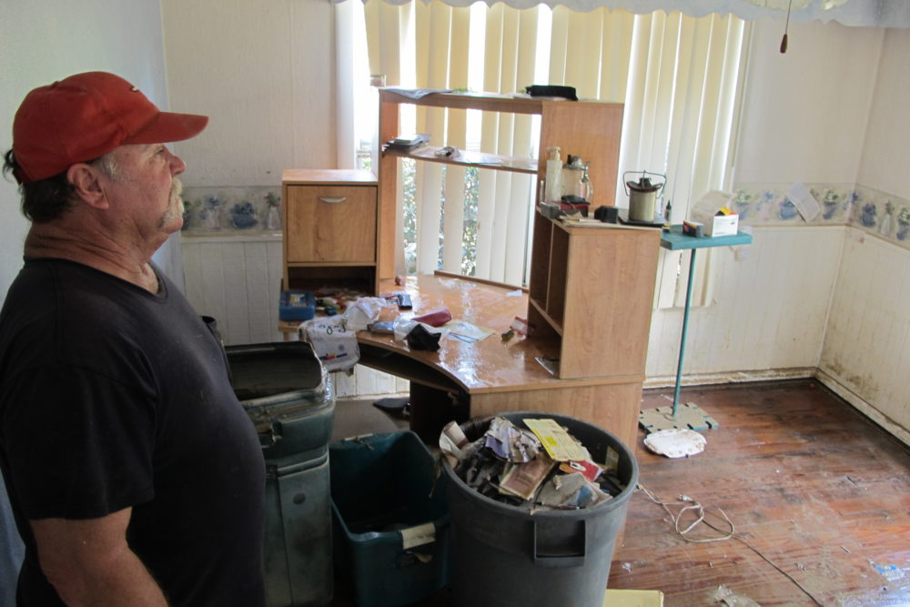 Dwight Chandler walks through his devastated home in Highlands, Texas on Thursday, Aug. 31, 2017. Chandler, 62, said he worried whether Harvey's floodwaters had also washed in pollution from the old acid pits that were designated as a U.S. EPA Superfund site just a couple blocks from his home. The Highlands Acid Pit site near Chandler's home was filled in the 1950s with toxic sludge and sulfuric acid from oil and gas operations.