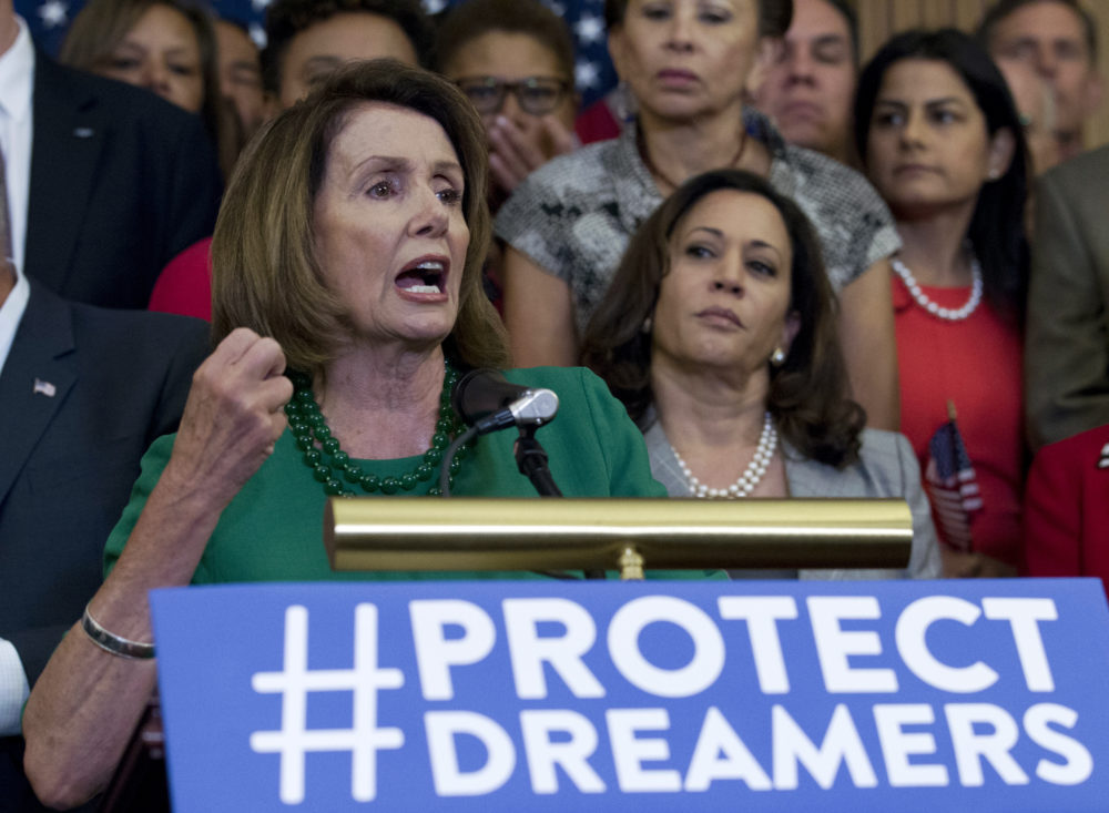 House Minority Leader Nancy Pelosi of Calif. accompanied by members of the House and Senate Democrats, gestures during a news conference on Capitol Hill in Washington, Wednesday, Sept. 6, 2017. House and Senate Democrats gather to call for Congressional Republicans to stand up to President Trump's decision to terminate the Deferred Action for Childhood Arrivals (DACA) initiative by bringing the DREAM Act for a vote on the House and Senate Floor.