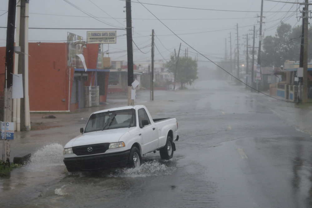 A man drives through rain and strong winds during the passage of hurricane Irma, in Fajardo, Puerto Rico, Wednesday, Sept. 6, 2017. The US territory was first to declare a state of emergency las Monday, as the National Hurricane Center forecast that the storm would strike the Island Wednesday. )