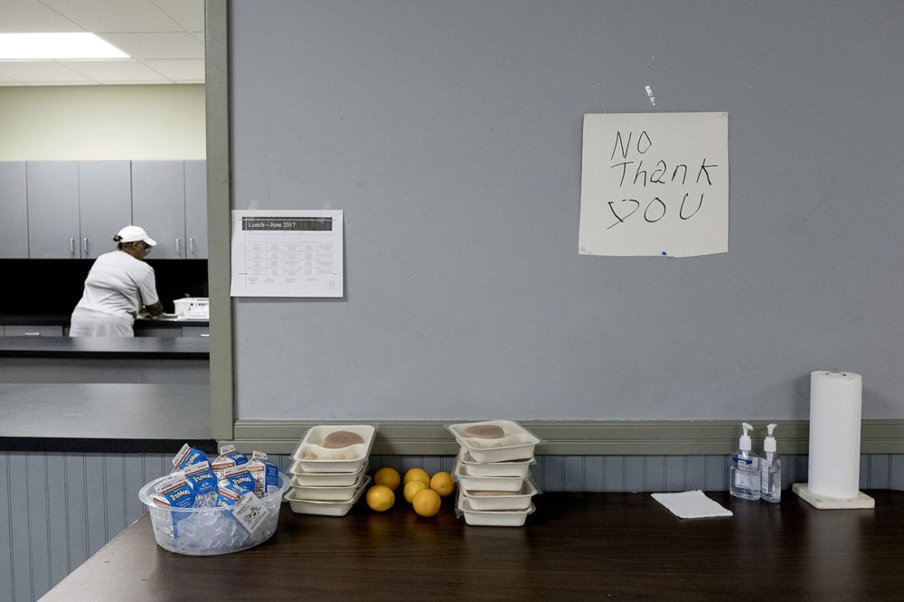 """Kids leave food they don't want on a """"No Thank You"""" table so others can pick it up at a community center in the East Texas community of Reklaw."""