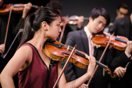 Natalie Lin, violinist performing with her ensemble KINETIC