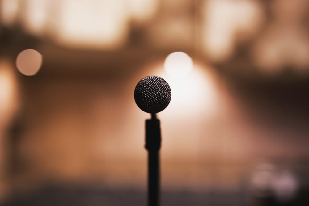 Microphone On A Podium In Front Of An Auditorium
