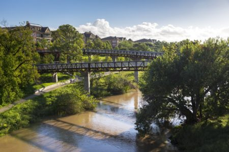 New pedestrian bridges provide more frequent crossing opportunities in Buffalo Bayou Park.