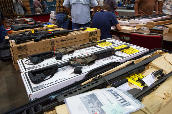 Sales surged for guns, such as these seen at a show in Kenner, La., in late 2012, after the mass shooting in Newtown, Conn.