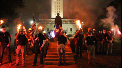 Austin, Texas, November 4, 2017: Approximately 25 Patriot Front members and associates, wearing masks and carrying burning torches, demonstrated in front of the George Washington statue at the University of Texas.