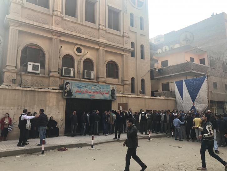 The attack outside the Coptic Church of Mar Mina left at least one policeman dead and five others wounded, including two critically.