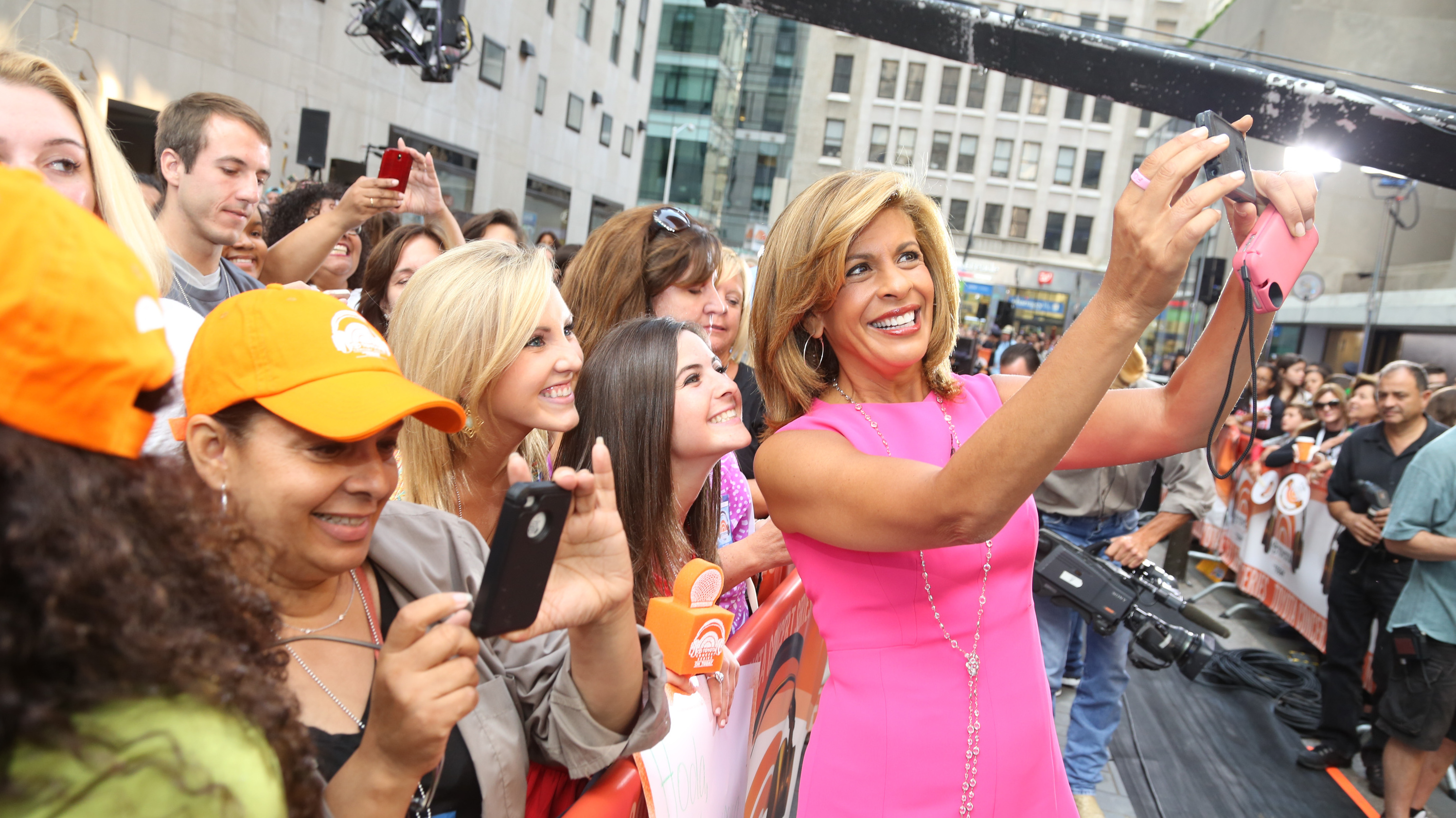 Hoda Kotb poses with guests outside of the Today show studios in 2014. Kotb has just been named co-anchor of the show, replacing longtime co-anchor Matt Lauer.