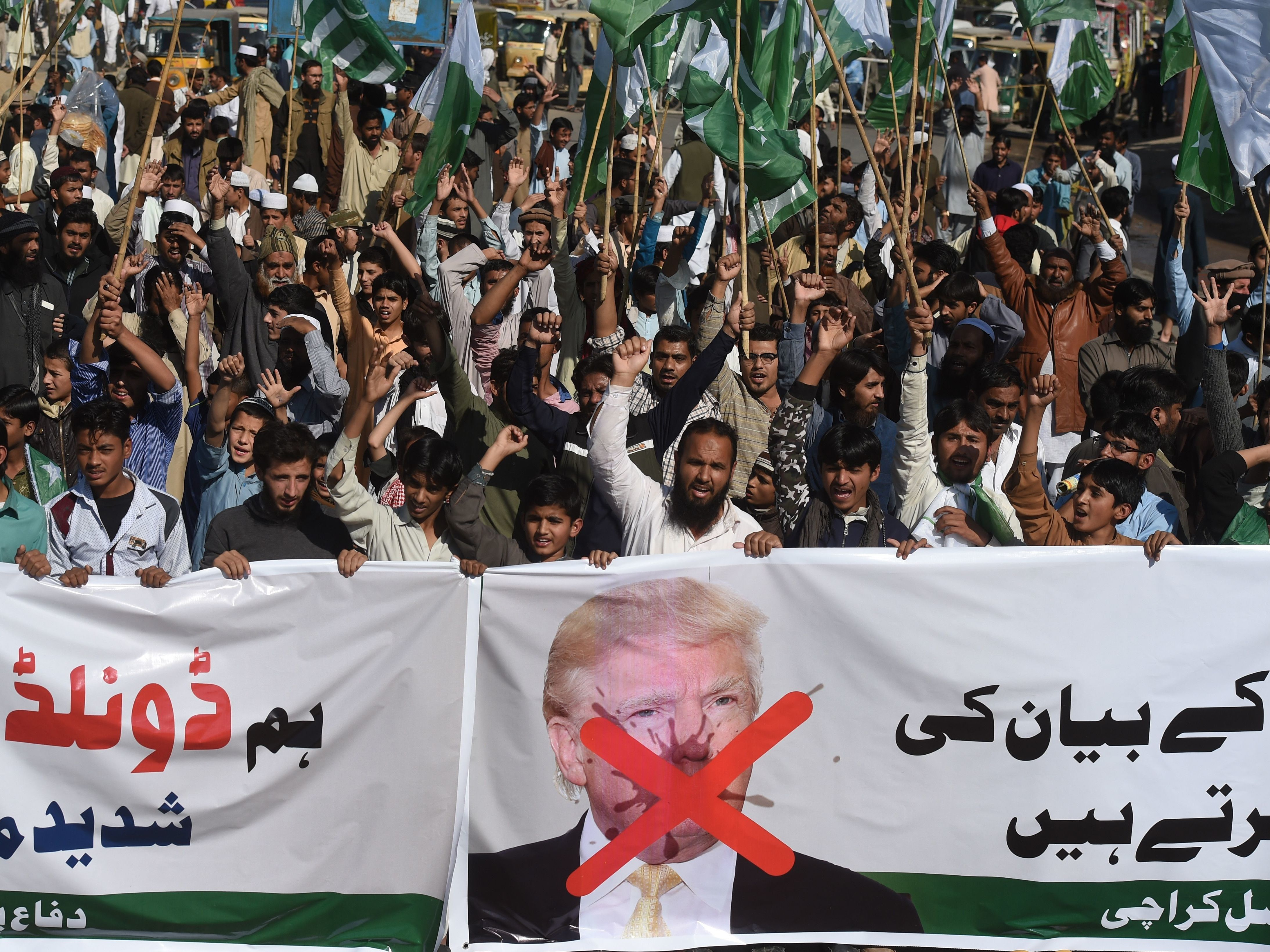 Activists of the Difa-e-Pakistan Council shout anti-U.S. slogans at a protest in Karachi on Tuesday. Pakistan summoned the U.S. ambassador after President Trump lashed out at Islamabad with threats to cut aid over