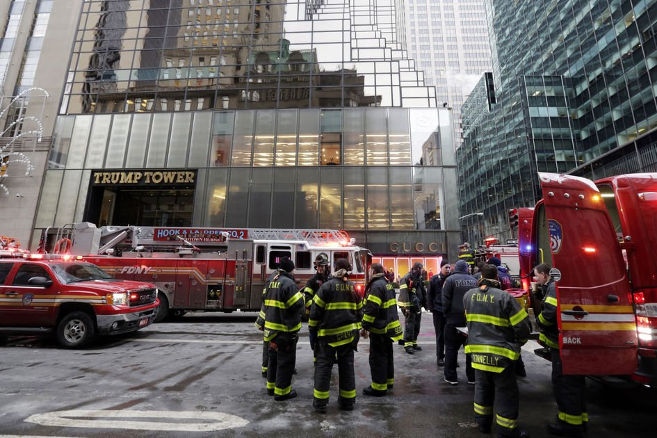 New York City Fire Department vehicles sit on Fifth Avenue in front of Trump Tower, in New York, Monday, Jan. 8, 2018.