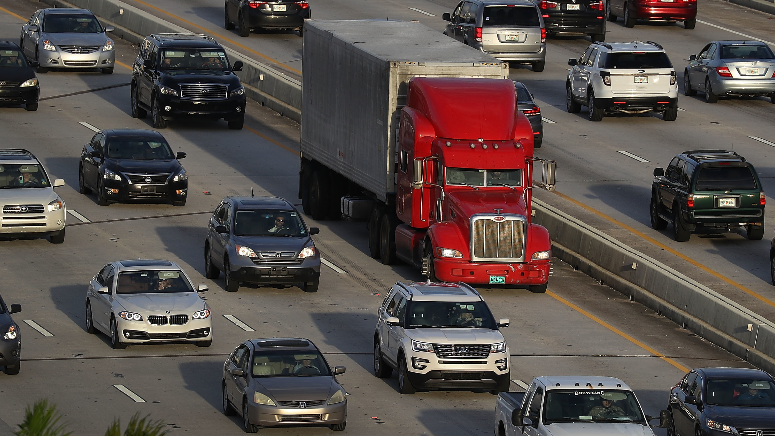 A tractor-trailer rolls along the highway in Miami last November. The trucking industry needs to hire almost 900,000 more drivers to meet rising demand, according to an industry analysis.