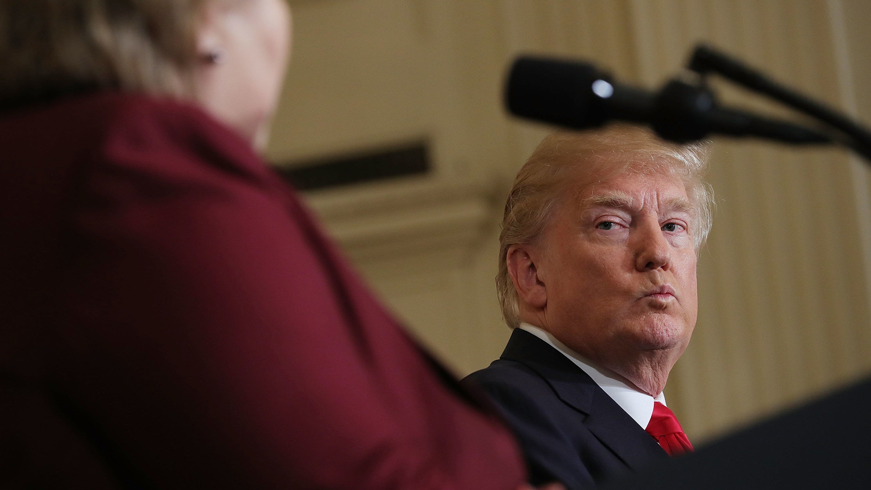President Trump listens as Norwegian Prime Minister Erna Solberg speaks at a joint news conference Wednesday. At an Oval Office meeting on immigration policy, Trump said the U.S. should want more people from countries like Norway, disparaging Haiti and what he called
