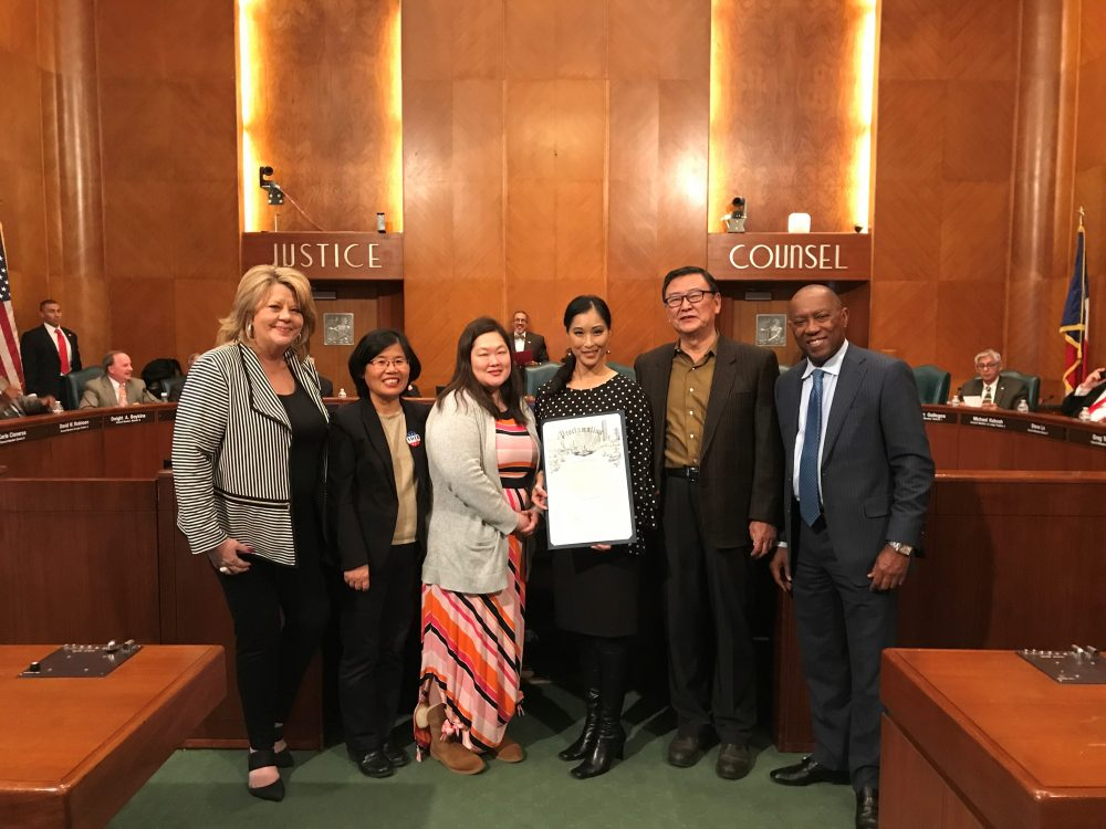 Joy Alessi (center) is co-director of the Adoptee Rights Campaign. In this photo she poses holding a proclamation passed by the Houston City Council in support of the campaign on January 23rd 2018.