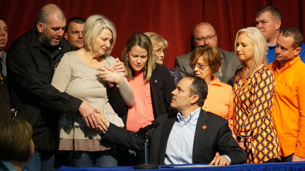 The parents of the deceased 15 year old Bailey Holt, left, stand in tears as Kentucky Gov. Matt Bevin signs the prayer proclamation on Friday, Jan. 26, 2018 in Benton, Ky.
