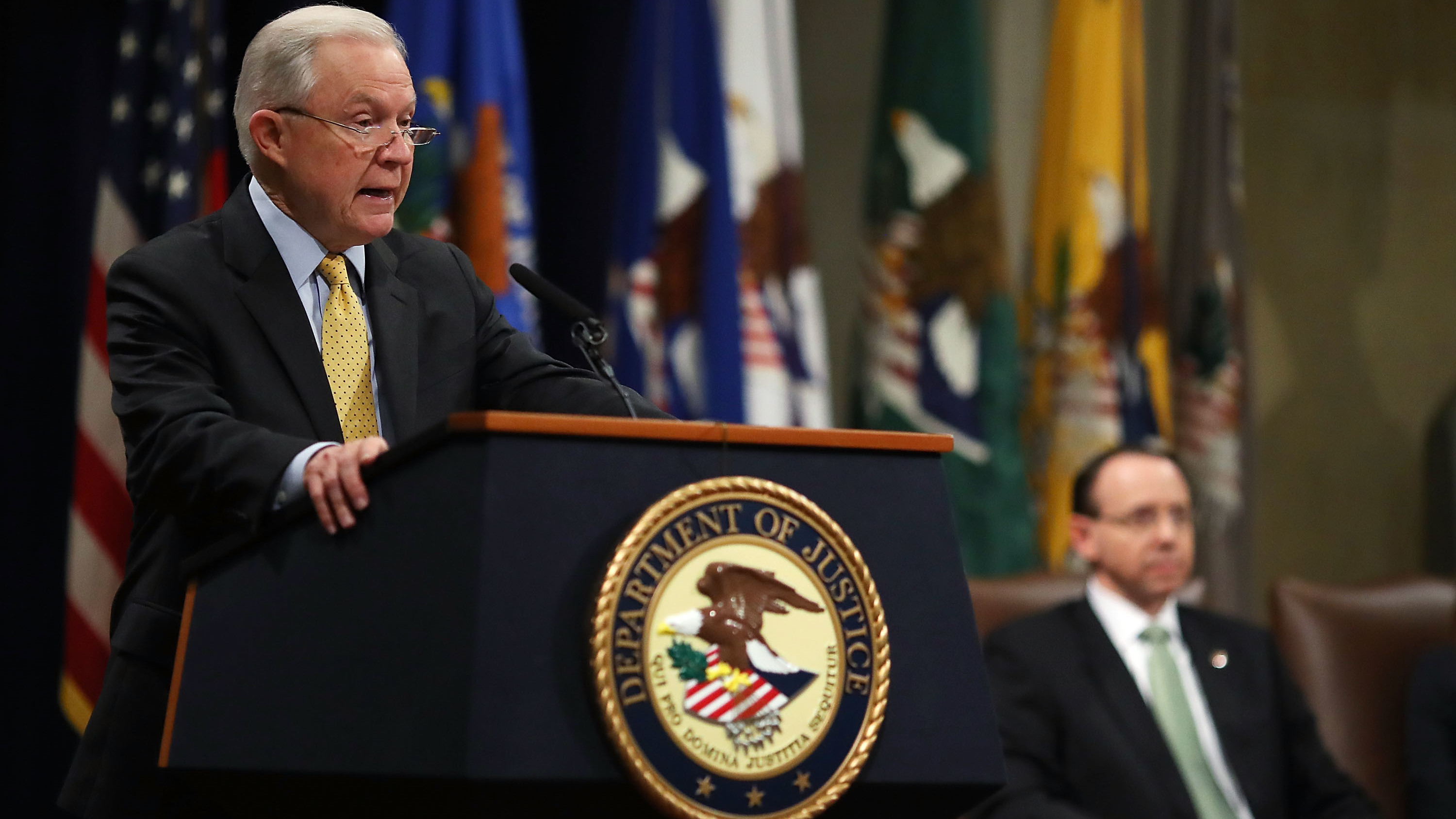 Attorney General Jeff Sessions (left) speaks while Deputy Attorney General Rod Rosenstein listens during a summit at the Justice Department on Feb. 2 in Washington, D.C., to discuss efforts to combat human trafficking.