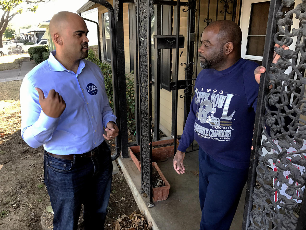 Colin Allred talks with Rickey Phillips as he knocks on doors in North Dallas to gin up support for his campaign for Texas' 32nd congressional district.