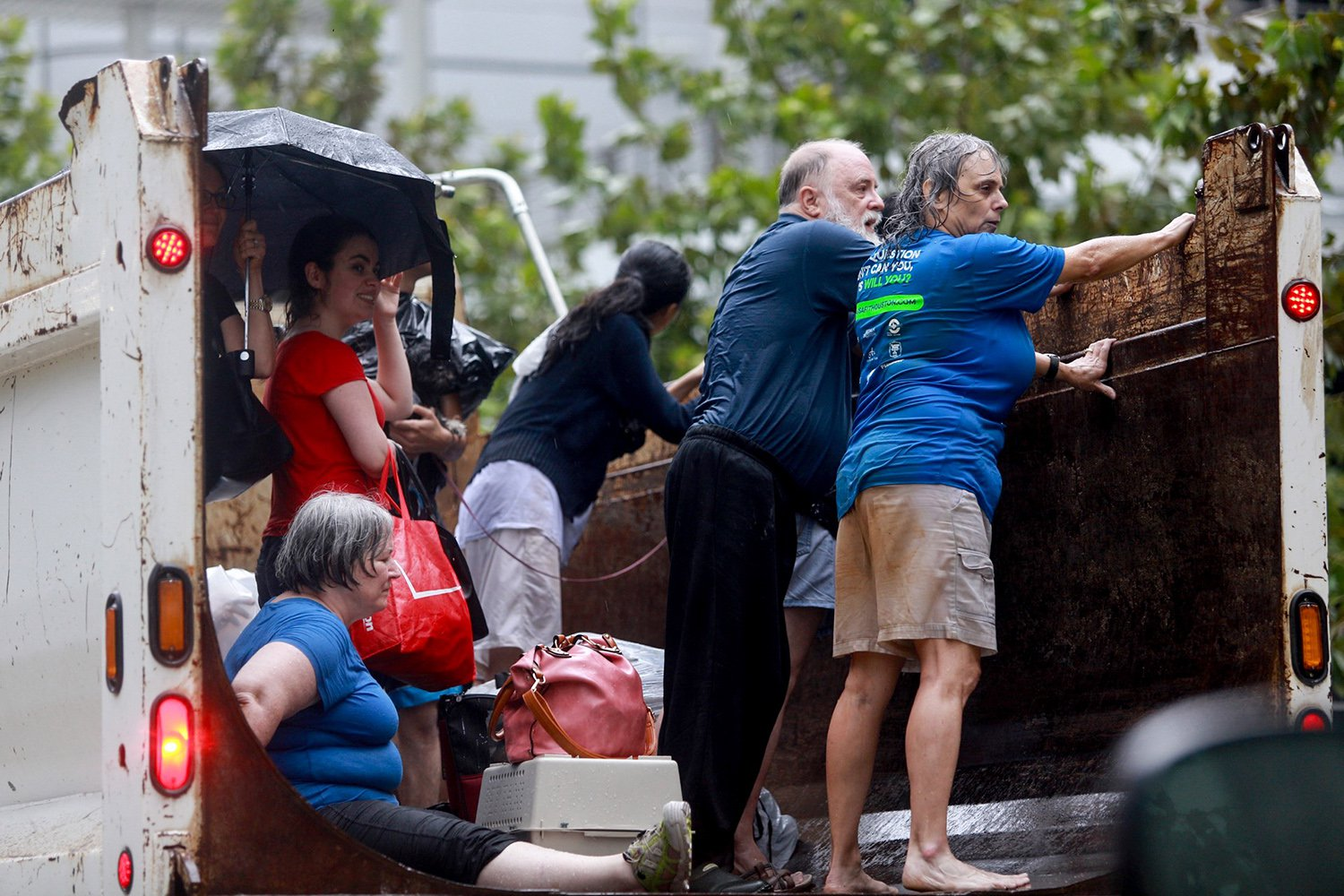 Evacuees from Meyerland — a neighborhood in southwest Houston hit hard by Harvey — arrive at the George R. Brown Convention Center on Sunday, Aug. 27, 2017.