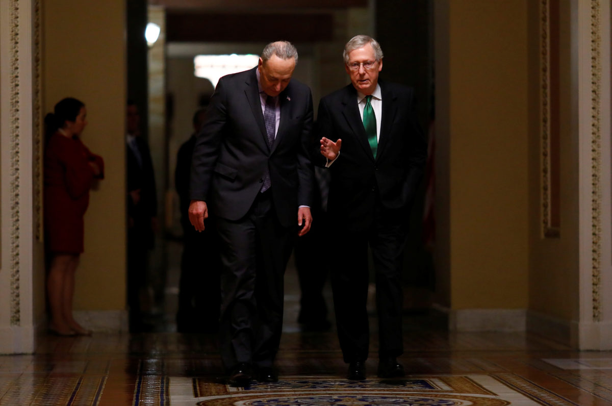Senate Minority Leader Chuck Schumer, D-N.Y., and Senate Majority Leader Mitch McConnell, R-Ky., seen walking to the Senate chamber on Capitol Hill on February 7, 2018.