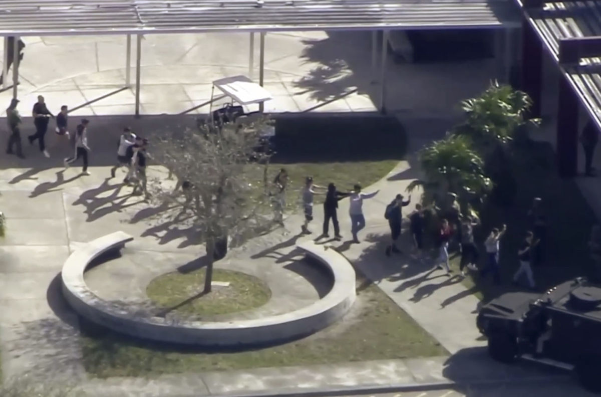 In this frame grab from video provided by WPLG-TV, students from the Marjory Stoneman Douglas High School in Parkland, Fla., evacuate the school following a shooting there on February 14th, 2018.