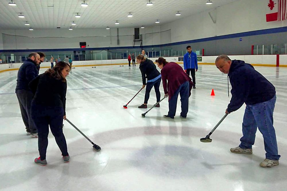 "Sweepers at one of the Houston Curling Club's ""Intro to Curling"" sessions."
