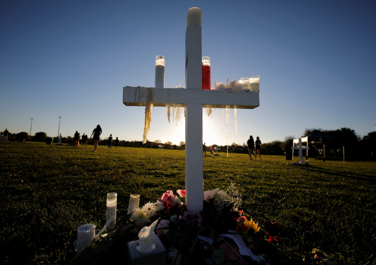 Candle drippings hang off one of 17 crosses at a memorial for the victims of the shooting at Marjory Stoneman Douglas High School in Parkland, Florida, U.S. February 16, 2018.